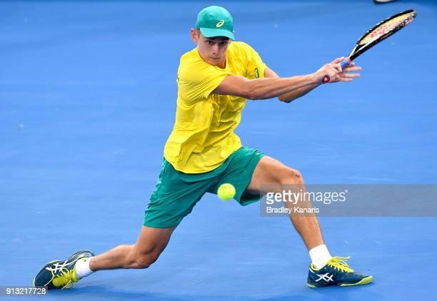 Alex de Minaur of Australia plays a backhand against Alexander Zverev of Germany during the Davis Cup World Group First Round tie between Australia...