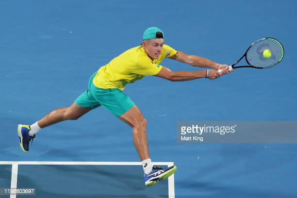Alex de Minaur of Australia plays a backhand during his semifinal singles match against Rafael Nadal of Spain during day nine of the 2020 ATP Cup at...