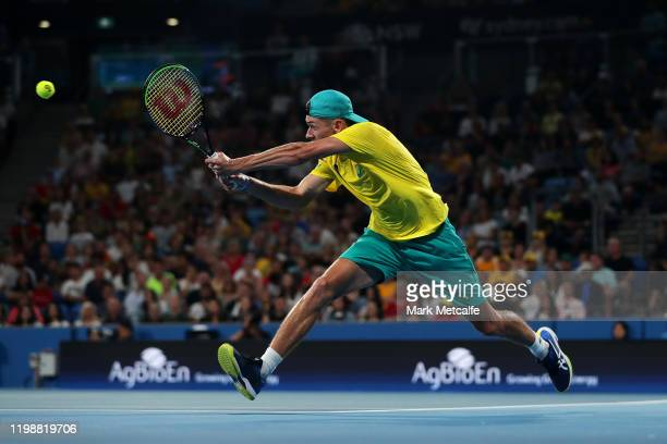 Alex de Minaur of Australia plays a backhand during his semi-final singles match against Rafael Nadal of Spain during day nine of the 2020 ATP Cup at...