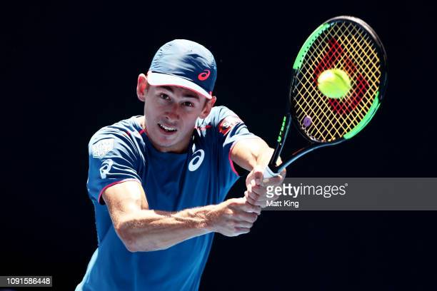 Alex De Minaur of Australia plays a backhand in his 2nd round match against Reilly Opelka of the United States during day four of the 2019 Sydney...