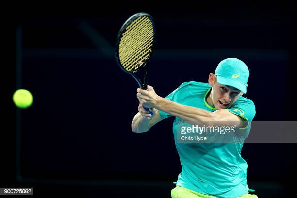 Alex De Minaur of Australia plays a backhand in his match against Milos Raonic of Canada during day four of the 2018 Brisbane International at Pat...