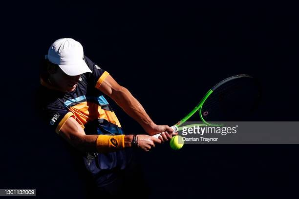 Alex De Minaur of Australia plays a backhand in his Men's Singles first round match against Tennys Sandgren of the United States during day two of...