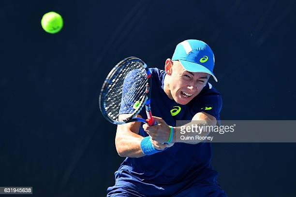 Alex De Minaur of Australia plays a backhand in his second round match against Sam Querrey of the United States on day three of the 2017 Australian...