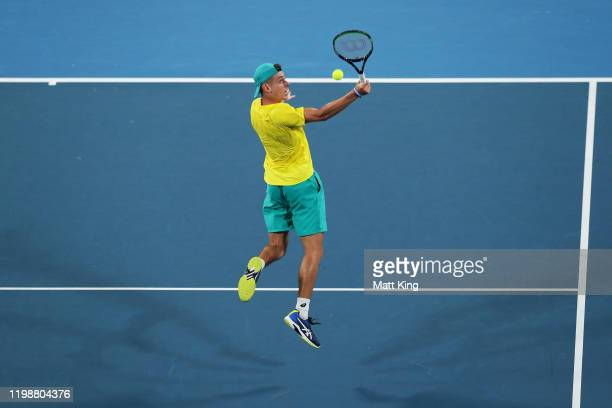 Alex de Minaur of Australia plays a backhand overhead smash during his semifinal singles match against Rafael Nadal of Spain during day nine of the...