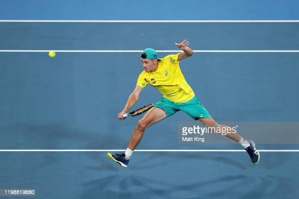 Alex de Minaur of Australia plays a backhand volley during his semifinal singles match against Rafael Nadal of Spain during day nine of the 2020 ATP...