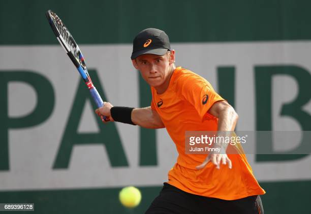 Alex De Minaur of Australia plays a forehand during the mens singles first round match against Robin Haas of the Netherlands on day one of the 2017...