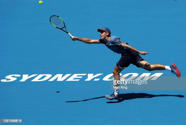 Alex De Minaur of Australia plays a forehand in his 2nd round match against Reilly Opelka of the United States during day four of the 2019 Sydney...