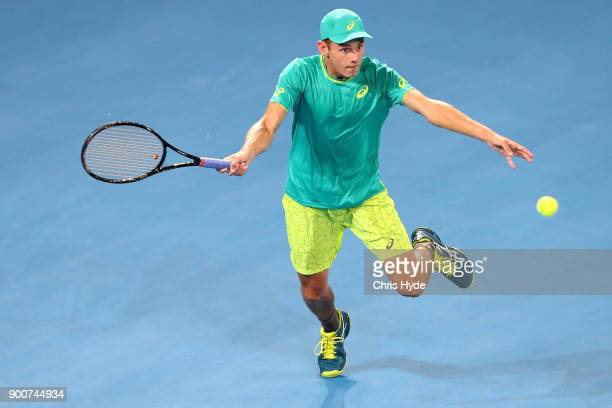 Alex De Minaur of Australia plays a forehand in his match against Milos Raonic of Canada during day four of the 2018 Brisbane International at Pat...
