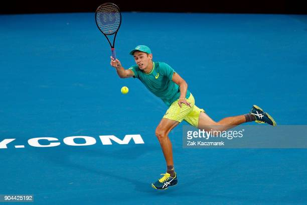 Alex de Minaur of Australia plays a forehand in his Men's Singles Final match against Daniil Medvedev of Russia during day seven of the 2018 Sydney...
