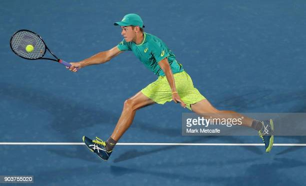 Alex de Minaur of Australia plays a forehand in his quarter final match against Feliciano Lopez of Spain during day five of the 2018 Sydney...