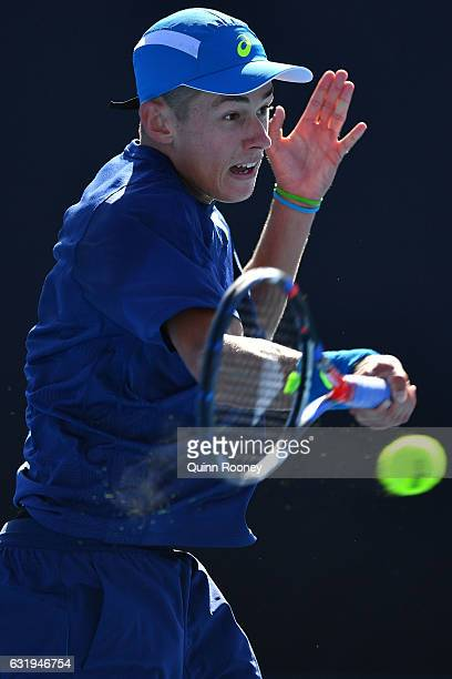 Alex De Minaur of Australia plays a forehand in his second round match against Sam Querrey of the United States on day three of the 2017 Australian...