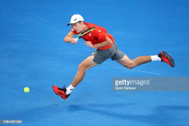 Alex De Minaur of Australia plays a forehand in his third round match against Rafael Nadal of Spain during day five of the 2019 Australian Open at...