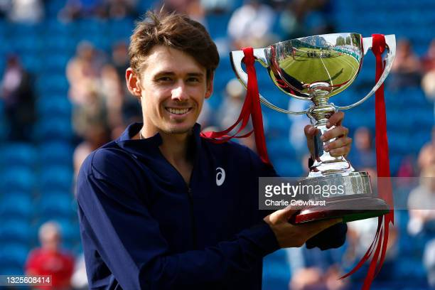 Alex De Minaur of Australia poses for a photo with the trophy after winning the mens singles final against Lorenzo Sonego of Italy during day 8 of...