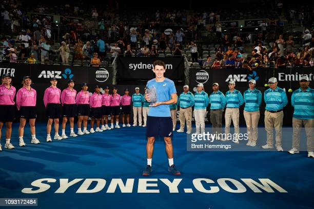 Alex De Minaur of Australia poses with his trophy after victory in his Mens Final match against Andreas Seppi of Italy during day seven of the 2019...