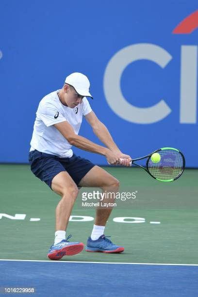 Alex De Minaur of Australia returns a backhand shot to Andrey Rublev of Russia during a semifinal match on Day Eight of the Citi Open at the Rock...