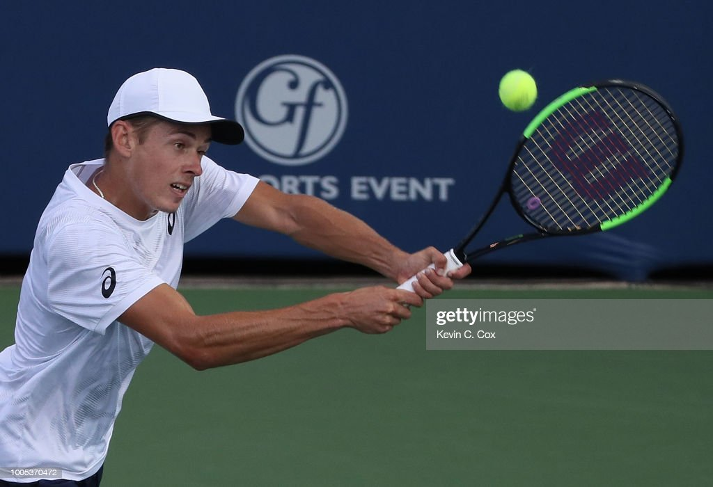 Alex De Minaur of Australia returns a backhand to John Isner during the BB&T Atlanta Open at Atlantic Station on July 25, 2018 in Atlanta, Georgia.