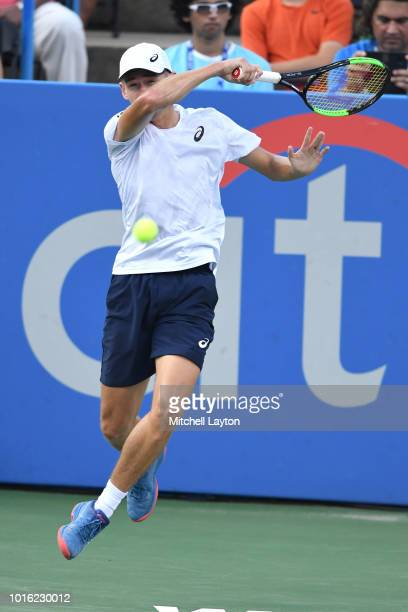 Alex De Minaur of Australia returns a forehand shot to Andrey Rublev of Russia during a semifinal match on Day Eight of the Citi Open at the Rock...