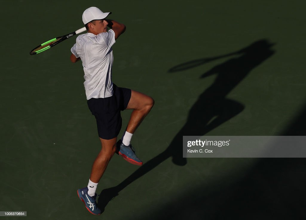 Alex De Minaur of Australia returns a forehand to John Isner during the BB&T Atlanta Open at Atlantic Station on July 25, 2018 in Atlanta, Georgia.
