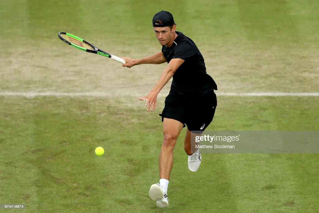 Alex De Minaur of Australia returns a shot to Christopher Eubanks of the United States during Day Six of the Nature Valley Open at Nottingham Tennis Centre on June 14, 2018 in Nottingham, United Kingdom.