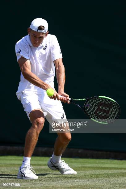 Alex De Minaur of Australia returns against Marco Cecchinato of Italy during their Men's Singles first round match on day two of the Wimbledon Lawn...