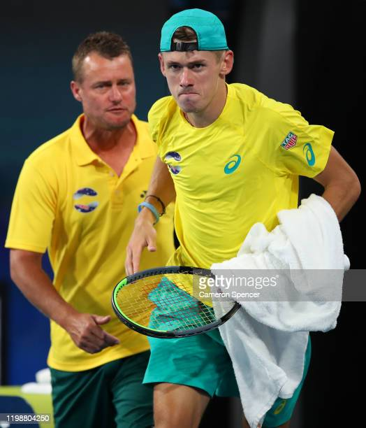 Alex de Minaur of Australia runs onto the court after winning the first set 64 in his semifinal singles match against Rafael Nadal of Spain on day...
