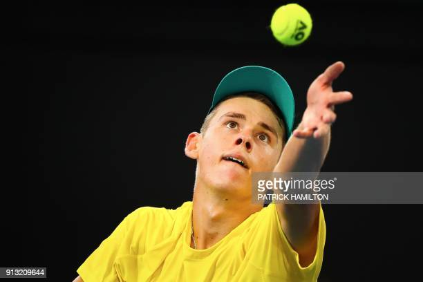 Alex De Minaur of Australia serves against Alexander Zverev of Germany during their men's singles tennis match in the Davis Cup World Group tie at...