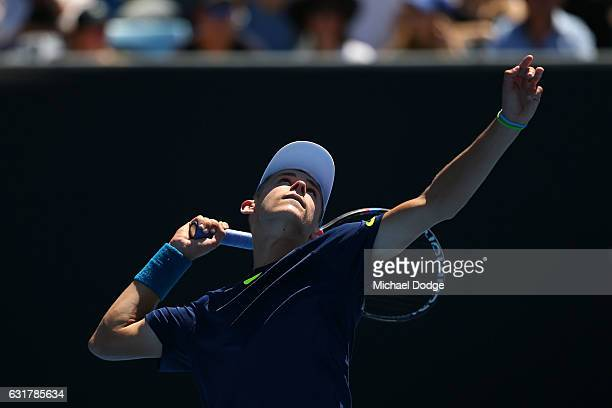 Alex De Minaur of Australia serves in his first round match against Gerald Melzer of Austria on day one of the 2017 Australian Open at Melbourne Park...