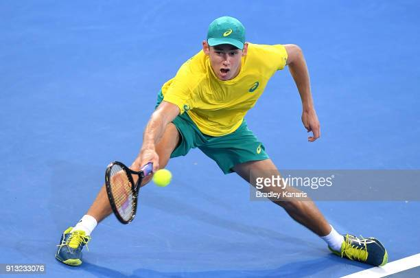 Alex de Minaur of Australia stretches out to play a shot against Alexander Zverev of Germany during the Davis Cup World Group First Round tie between...