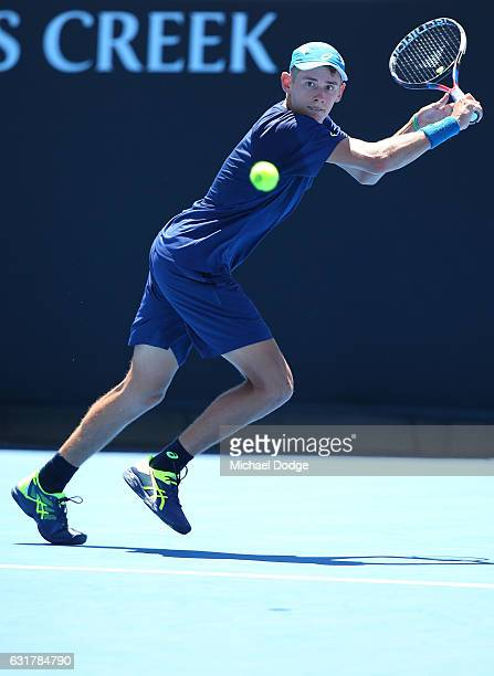 Alex De Minaur of Australiaplays a backhand in his first round match against Gerald Melzer of Austria on day one of the 2017 Australian Open at...