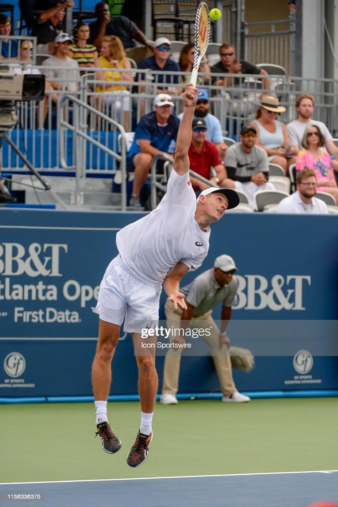 Alex De Minaur serving during the singles final of the BB&T