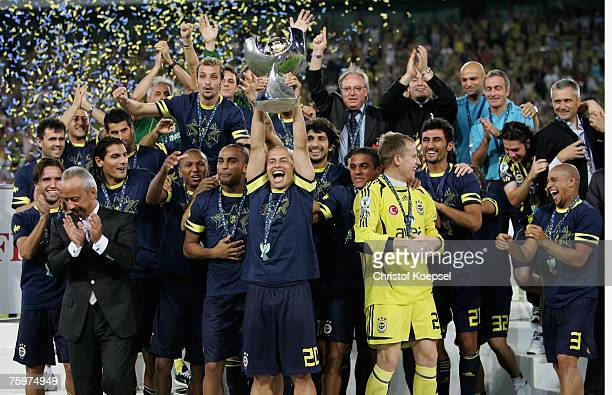 Alex de Souza of Fenerbahce holds the winning trophee during the podium after the Sueper Kupa Cup match between Fenerbahce SK and Besiktas JK at the...