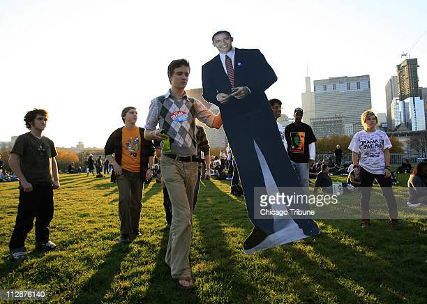 Alex Deaton of St Louis Missouri walks with a cardboard cutout of his presidential candidate during an election night rally for Barack Obama in Grant...