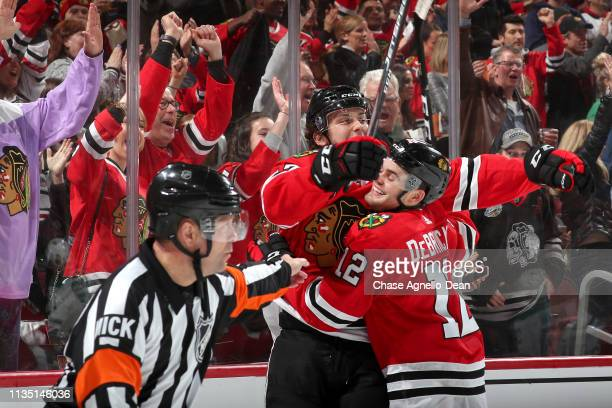 Alex DeBrincat and Dylan Strome of the Chicago Blackhawks celebrate after Strome scored against the Dallas Stars in the second period at the United...
