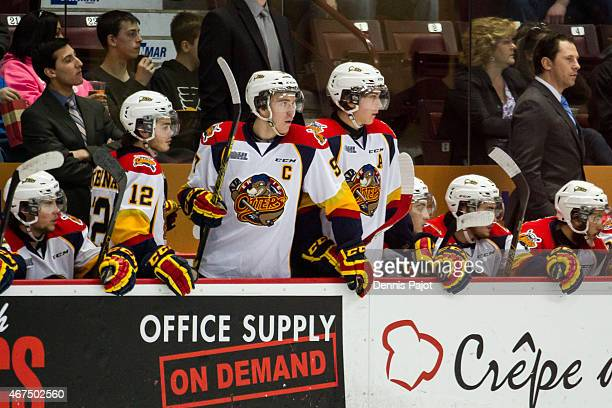 Alex DeBrincat Dylan Strome and Connor McDavid of the Erie Otters prepare for a shift change during a game against the Windsor Spitfires on March 19...