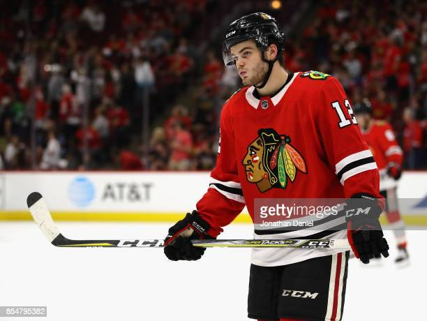 Alex DeBrincat of the Chicago Blackhawks awaits a face off against the Columbus Blue Jackets during a preseason game at the United Center on...