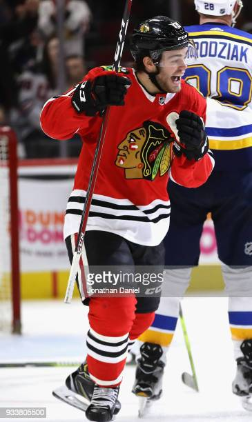Alex DeBrincat of the Chicago Blackhawks celebrates after scoring his third goal of the game for a hat trick against the St Louis Blues at the United...
