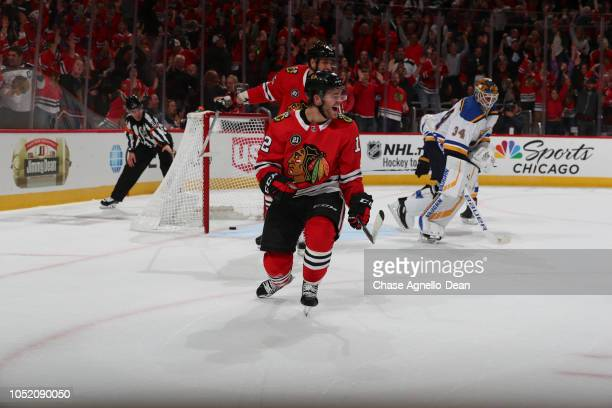Alex DeBrincat of the Chicago Blackhawks celebrates his game winning goal in overtime against the St Louis Blues at the United Center on October 13...
