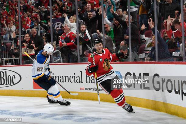 Alex DeBrincat of the Chicago Blackhawks celebrates his goal against the St Louis Blues during the third period at the United Center on October 13...
