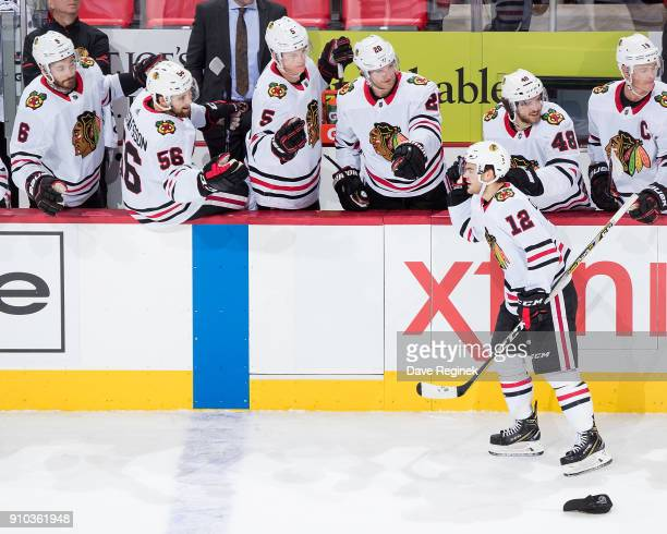 Alex DeBrincat of the Chicago Blackhawks celebrates his hat trick during an NHL game against the Detroit Red Wings at Little Caesars Arena on January...
