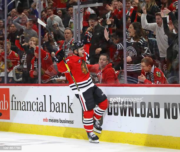 Alex DeBrincat of the Chicago Blackhawks celebrates scoring a goal against the Calgary Flames at the United Center on January 07 2019 in Chicago...