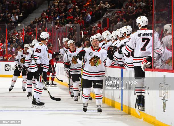 Alex DeBrincat of the Chicago Blackhawks celebrates with the bench after a first period goal on the Ottawa Senators at Canadian Tire Centre on...