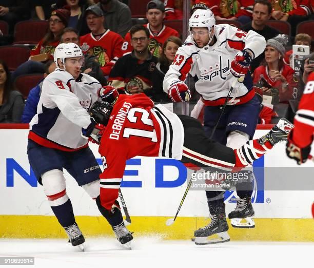 7d20c9e4a Alex DeBrincat of the Chicago Blackhawks collides with Tom Wilson and  Dmitry Orlov of the Washington. Washington Capitals v Chicago Blackhawks