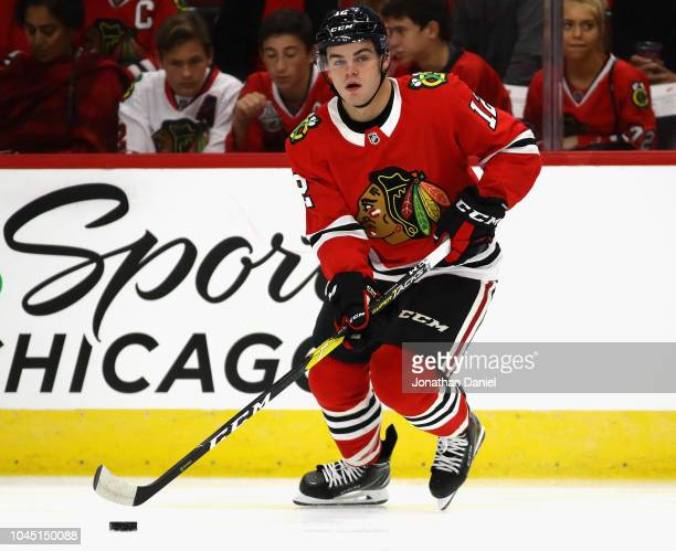 Alex DeBrincat of the Chicago Blackhawks controls the puck against the Detroit Red Wings during a preseason game at the United Center on September 25...