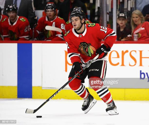 Alex DeBrincat of the Chicago Blackhawks controls the puck against the Detroit Red Wings during a preseason game at the United Center on September 21...