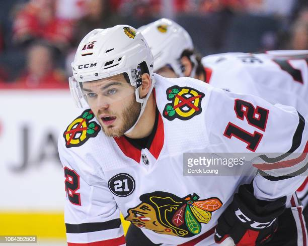 Alex DeBrincat of the Chicago Blackhawks in action against the Calgary Flames during an NHL game at Scotiabank Saddledome on November 3 2018 in...