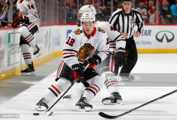 Alex DeBrincat of the Chicago Blackhawks in action against the New Jersey Devils on December 23 2017 at Prudential Center in Newark New Jersey The...