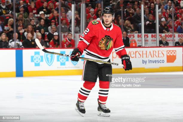 Alex DeBrincat of the Chicago Blackhawks looks down the ice in the second period against the Montreal Canadiens at the United Center on November 5...