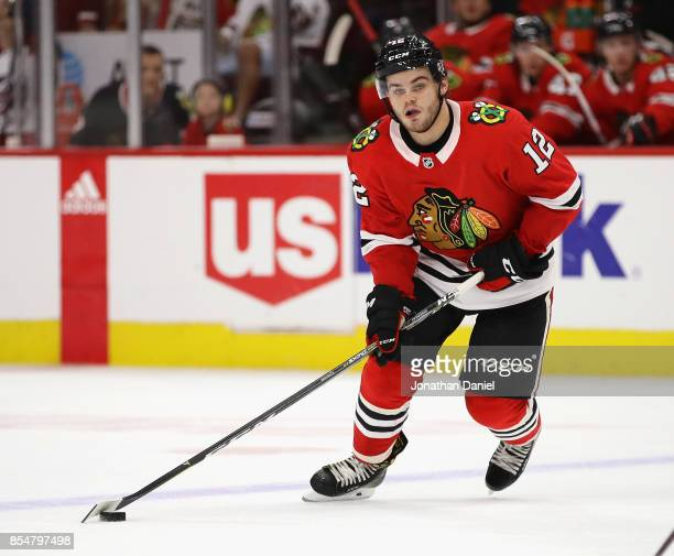 Alex DeBrincat of the Chicago Blackhawks looks to pass against the Columbus Blue Jackets during a preseason game at the United Center on September 23...