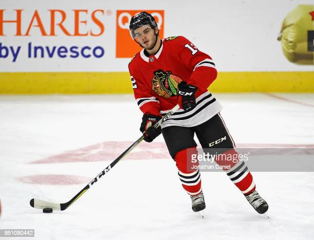 Alex DeBrincat of the Chicago Blackhawks participates in warmups before a preseason game against the Detroit Red Wings at the United Center on...