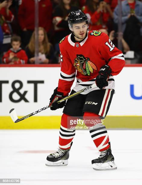 Alex DeBrincat of the Chicago Blackhawks participates in warmups before the season opening game against the Pittsburgh Penguins at the United Center...